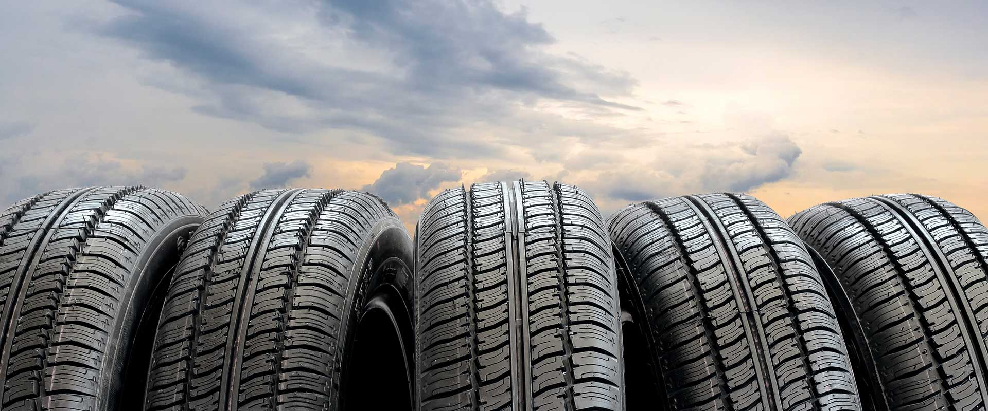 5 tires with a early morning sky background